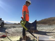 UA student measuring generated dust concentrations