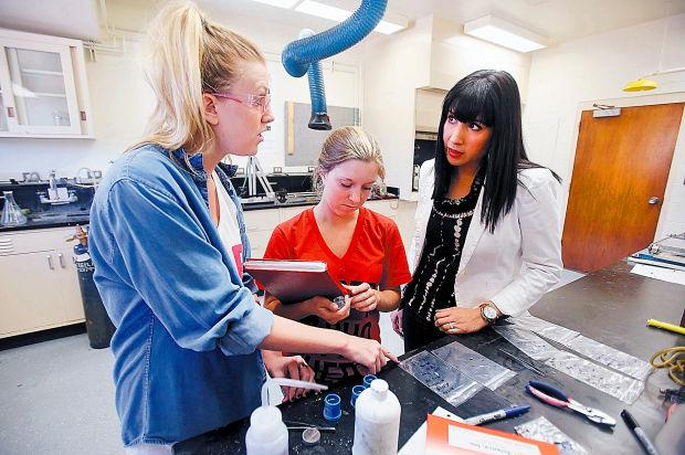 Anne Ellis, center, shown working in the Corral Lab with Ashley Ormsby, left, and Dr. Erica Corral, right. Photo courtesy Arizona Daily Star.
