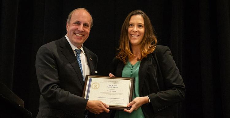 Erin Ratcliff receiving an award from Department of Energy Under Secretary for Science Paul Dabber