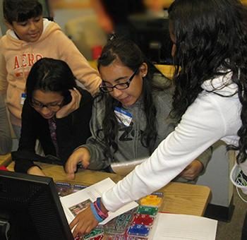Girl power! A group of Mansfeld Middle School students puts together a circuit board during UA Science Day 2013.