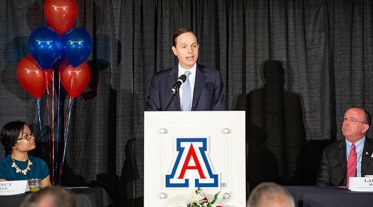 Dylan Taylor speaking at a podium
