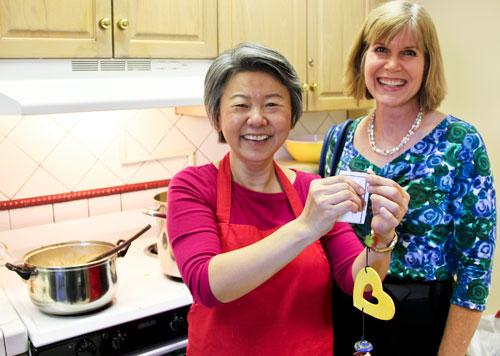 Professor Supapan Seraphin, left, takes a break from making curry to show her Ben's Bell, with engineering instructor Jennifer Horner, who nominated Seraphin for the award. (Pete Brown/UA Engineering)