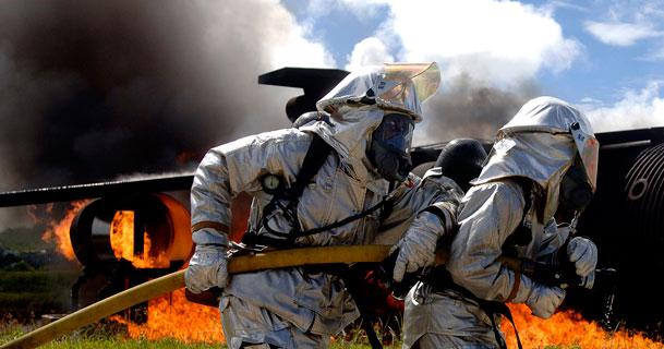 Firefighters work to put out a fire as part of a simulated aircraft crash during an exercise at Anderson Air Force Base in Guam. The routine exercise is conducted at the base a few times a year to sharpen the mobility and wartime capabilities of participating service members. (U.S. Air Force photo by Staff Sgt. Bennie J. Davis III)