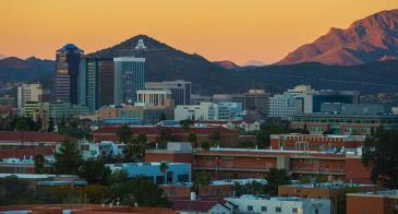 The UA campus at sunset with the block A on Sentinel Peak visible in the distance
